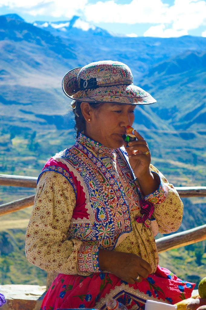 Peruvian woman selling souvenirs at the market at the colca canyon