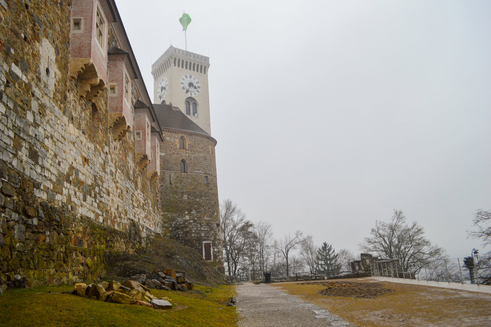 gothic clock tower with mist at castle