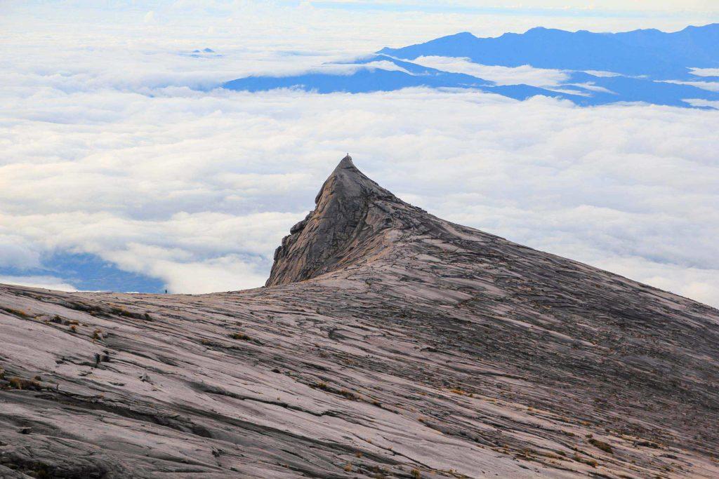 Mount Kinabalu granite peak with clouds behind