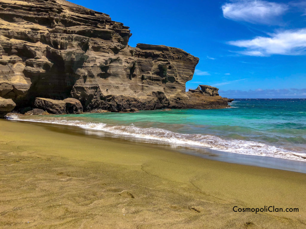 green sand beach with turquoise waters