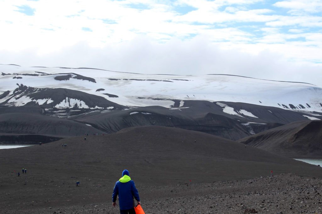 black sand and snow in the Antarctic