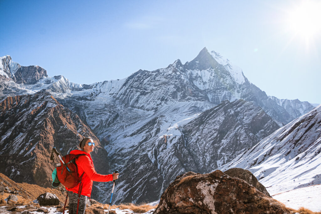 girl hiking on snow capped mountains