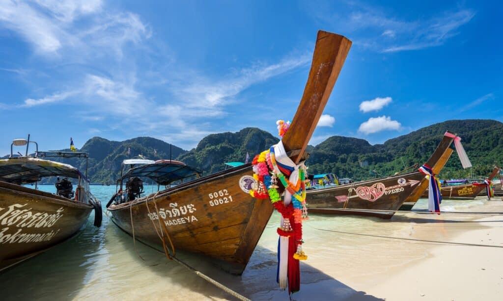 Tourist boat on Thai island beach